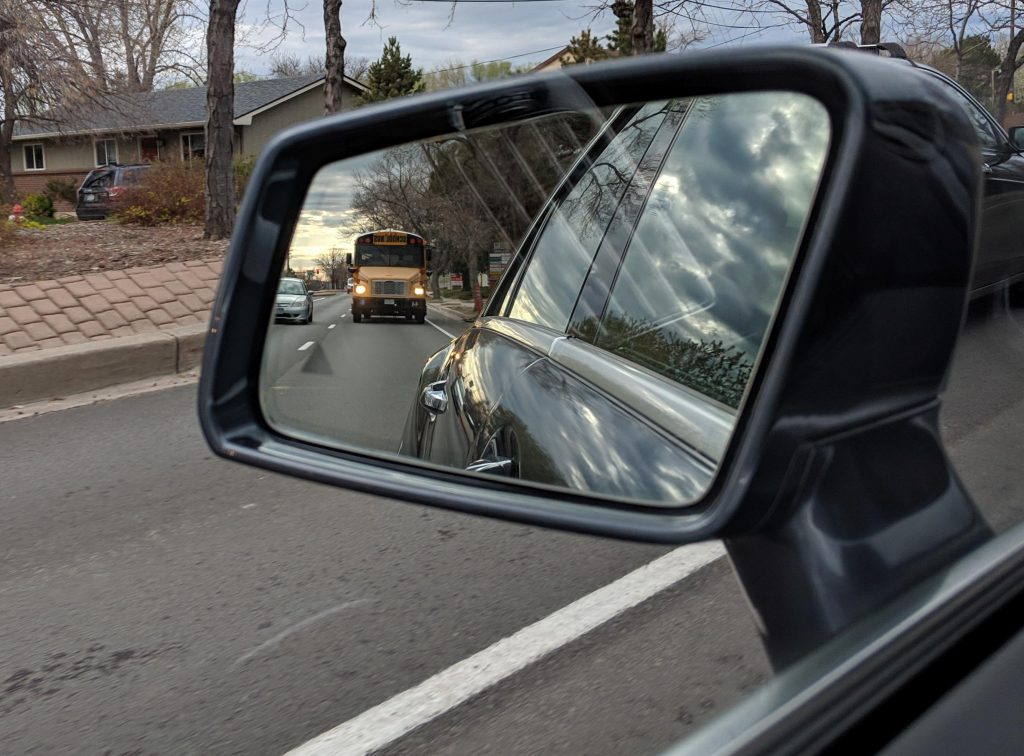 School Bus in rear view mirror